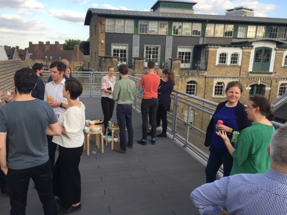 Photo of all practices networking on roof terrace