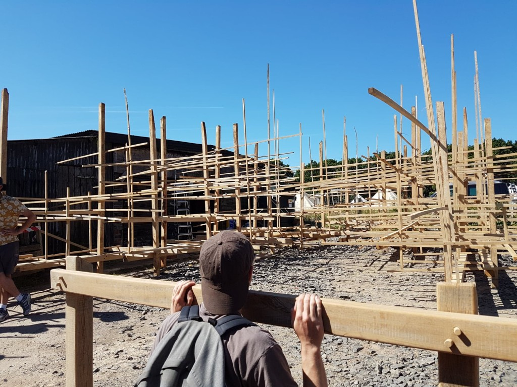 Photo of students looking onto timber structures