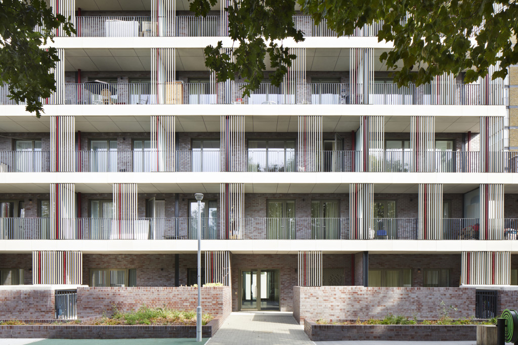 a view of the rear of the building adnd the balconies for the individual apartments looking at the shared garden