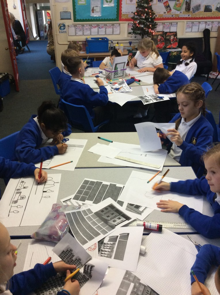 Children using images of buildings for inspiration
