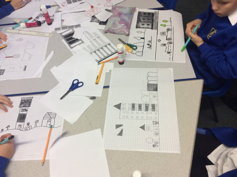 School children drawing buildings