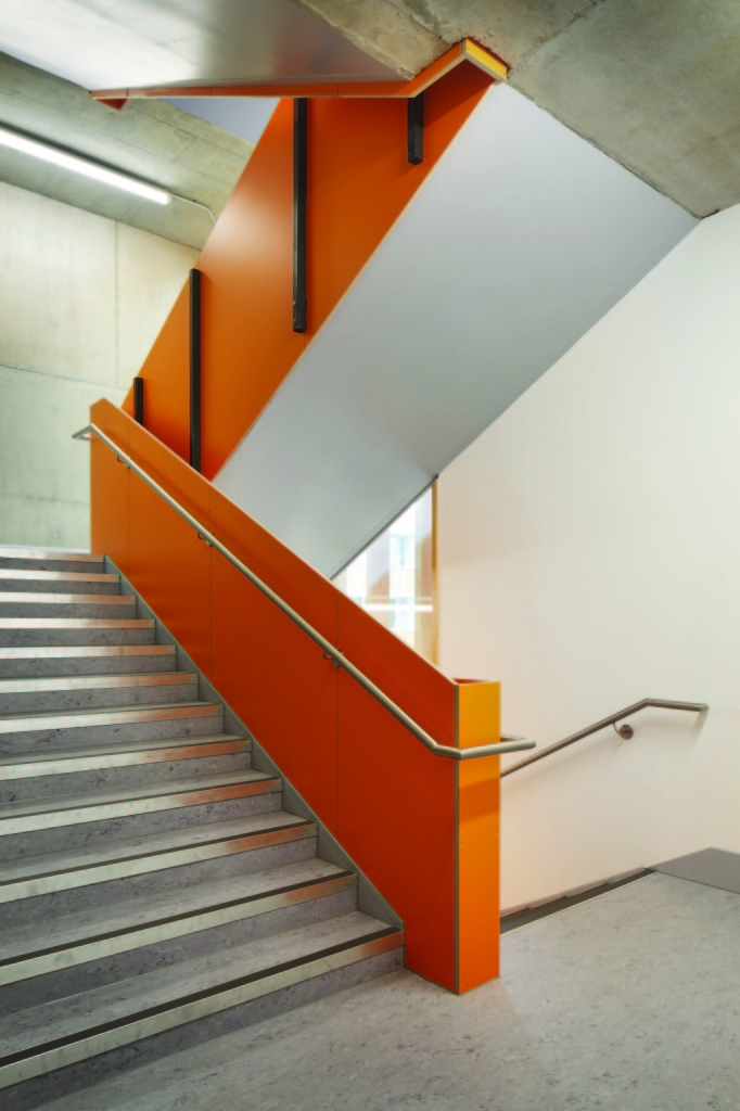 A bright orange staircase in a school