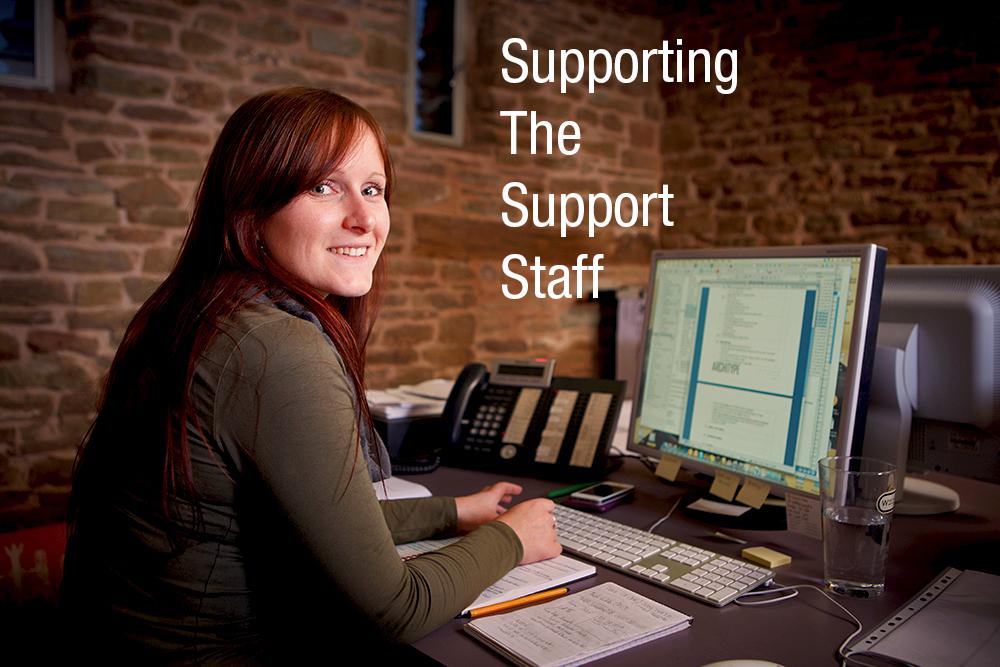 Lisa sitting at her desk